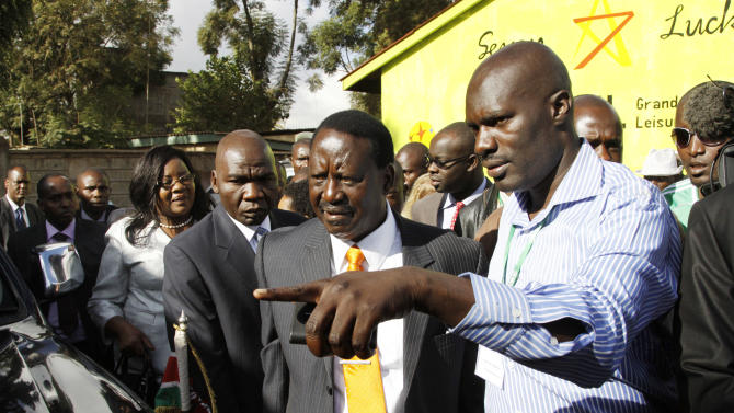 Kenyan Prime Minister and presidential candidate Raila Odinga, center,  arrives at a local poling station to vote in a general election in Nairobi, Kenya Monday, March 4, 2013. Kenya on Monday is holding its first presidential election since the 2007 vote which ushered in months of tribal violence that killed more than 1,000 people and displaced 600,000 from their homes. (AP Photo/ Khalil Senosi)