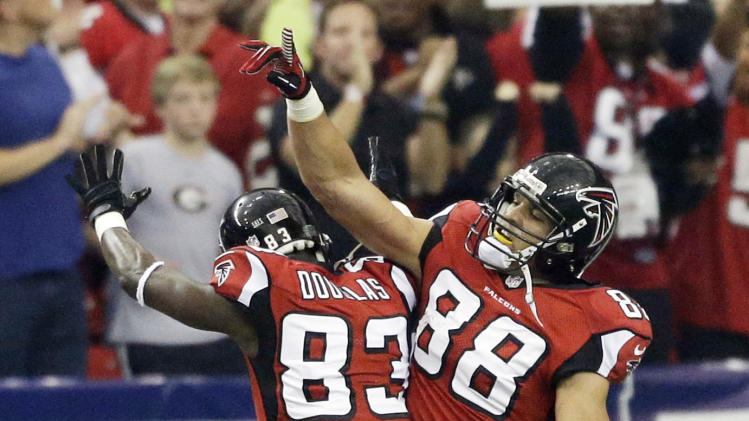 Atlanta Falcons tight end Tony Gonzalez (88) celebrates his touchdown with Atlanta Falcons wide receiver Harry Douglas (83) during the first half of an NFC divisional playoff NFL football game against the Seattle Seahawks Sunday, Jan. 13, 2013, in Atlanta. (AP Photo/David Goldman)