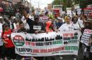 "People march during the ""We Will Not Go Back"" march and rally for Eric Garner in the Staten Island borough of New York"