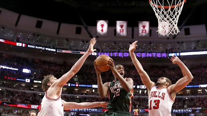 Milwaukee Bucks guard Khris Middleton (22) drives between Chicago Bulls forward Pau Gasol, left, and Joakim Noah during the second half in Game 2 of the NBA basketball playoffs Monday, April 20, 2015, in Chicago. The Bulls won 91-82. (AP Photo/Charles Rex Arbogast)