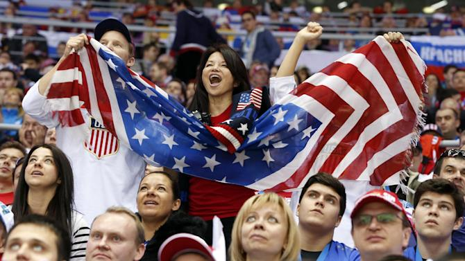 US fans cheer a second period goal by the USA against Russia during a men's ice hockey game at the 2014 Winter Olympics, Saturday, Feb. 15, 2014, in Sochi, Russia