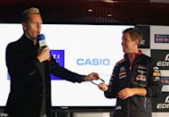 MELBOURNE, AUSTRALIA - MARCH 13: Sebastian Vettel of Germany and Infiniti Red Bull Racing is seen in stage with Illusionist Matt Hollywood during a press conference prior to the Australian Formula One Grand Prix at the Eureka Tower, on March 13, 2014 in Melbourne, Australia. (Photo by Robert Cianflone/Getty Images)