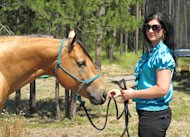 This photo taken Aug. 7, 2012 shows Sara Weaver at her horse at her ranch outside Kalispell, Mont. Weaver has finally forgiven the federal agents who 20 years ago shot her mother and younger brother to death during the siege at Idaho's Ruby Ridge. (AP Photo/Nicholas K. Geranios)