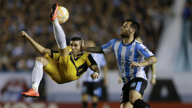 Jorge Mendoza of Paraguay's Guarani, left,  does a bicycle kick as Ezequiel Videla of Argentina's Racing Club tries to stop him during a Copa Libertadores quarter finals soccer match in Buenos Aires, Argentina, Thursday, May 28, 2015. (AP Photo/Natacha Pisarenko)