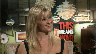 Reese Witherspoon flashes her dazzling smile at the 'This Means War' junket in Los Angeles on February 3, 2012 -- Access Hollywood