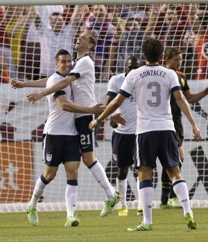 U.S. defender Geoff Cameron, left, celebrates with Clarence Goodson after Cameron scored during the first half of an international friendly soccer game against Belgium on Wednesday, May 29, 2013, in Cleveland. (AP Photo/Tony Dejak)