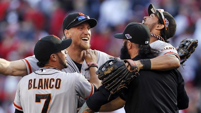 San Francisco Giants', from left, Gregor Blanco, Hunter Pence, Brian Wilson, and Angel Pagan celebrate after they defeated the Cincinnati Reds 6-4 in Game 5 of the National League division baseball series, Thursday, Oct. 11, 2012, in Cincinnati.  The Giants won the final three games, all in Cincinnati, and advanced to the NL championship series. (AP Photo/David Kohl)