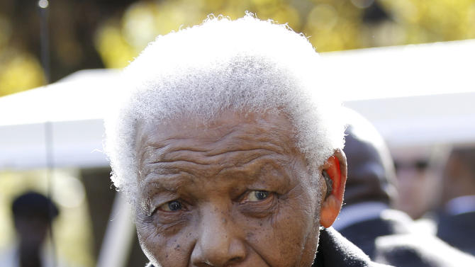 """FILE -In this June 17, 2010 file photo, former South African President, Nelson Mandela  leaves the chapel after attending the funeral of his great-granddaughter Zenani Mandela in Johannesburg, South Africa.  South African President Jacob Zuma says that former President Nelson Mandela has been admitted to hospital in Pretoria to undergo tests. Zuma issued a statement Saturday, Dec. 8, 2012 saying that Mandela is """"doing well and there is no cause for alarm."""" (AP Photo/Siphiwe Sibeko, Pool, File)"""