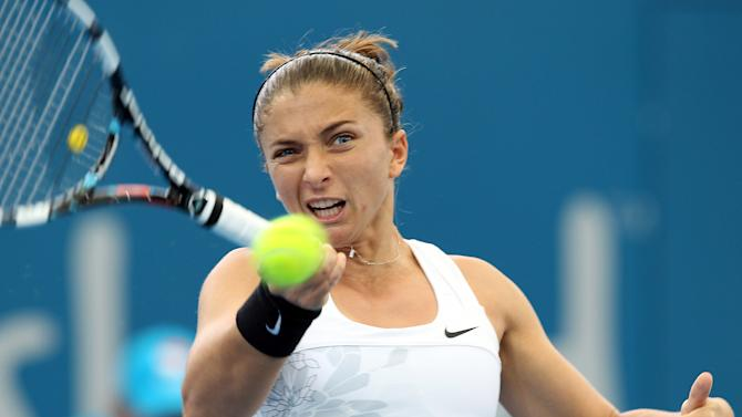 Sara Errani of Italy plays a shot during her first round match against Daniela Hantuchova of Slovakia during the Brisbane International tennis tournament in Brisbane, Australia, Tuesday, Jan 1, 2013.  (AP Photo/Tertius Pickard)