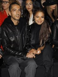 U.S. singer Janet Jackson (R) and her boyfriend Wissam Al Mana attend the Roberto Cavalli Autumn/Winter 2013 collection at Milan Fashion Week February 23, 2013. REUTERS/Alessandro Garofalo