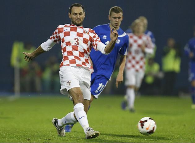 In this Nov. 19, 2013 file picture Croatia's defender Josip Simunic, left, is challenged by Iceland's Alfred Finnbogason during their World Cup qualifying playoff second leg soccer match against Icela