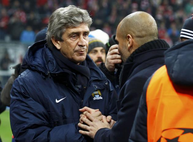 Manchester City coach Pellegrini and Bayern Munich coach Guardiola chat before their Champions League Group D soccer match in Munich