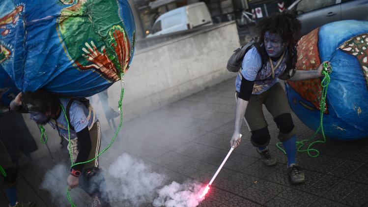 Actors take part in street theatre organized by the Coordinator of NGO's of the Basque Country in Bilbao