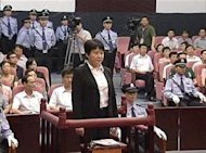 Gu Kailai (front, C), wife of ousted Chinese Communist Party Politburo member Bo Xilai, attends a trial in the court room at Hefei Intermediate People's Court in this still image taken from video August 9, 2012. REUTERS/CCTV via Reuters TV