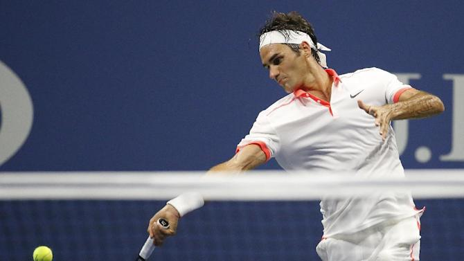 Roger Federer, of Switzerland, hits a forehand to Steve Darcis, of Belgium, during the second round of the U.S. Open tennis tournament in New York, Thursday, Sept. 3, 2015. Federer won 6-1, 6-2, 6-1. (AP Photo/Julio Cortez)