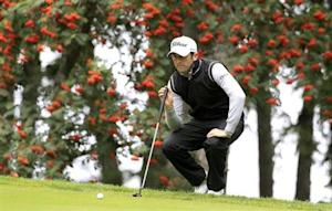 Bourdy of France lines his putt on the 6th green during the European Masters golf tournament in Crans-Montana