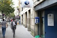 People walk past a Pole Emploi agency, France's employment agency, on September 3, 2012 in Paris. Unemployment continues to rise in France, with the number of jobseekers hitting the symbolic number of three million