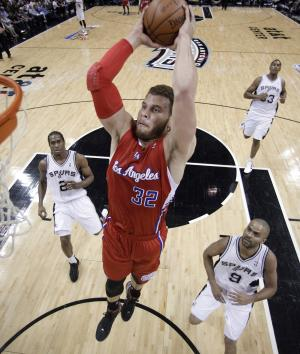 FILE - In this May 15, 2012, file photo, Los Angeles Clippers' Blake Griffin (32) soars to the basket past San Antonio defenders Tony Parker (9), of France, Kawhi Leonard (2) and Boris Diaw (33), of France, during the first quarter of Game 1 of an NBA basketball Western Conference semifinal playoff series in San Antonio. The Clippers signed Griffin to a five-year contract extension that could be worth up to $95 million, the team announced on Tuesday, July 10, 2012. (AP Photo/Eric Gay, File)