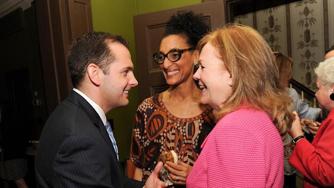 """IMAGE DISTRIBUTED FOR CHASE SAPPHIRE PREFERRED - Director of Marketing for Chase Sapphire Preferred, Jeff Bedard, left, chats with  James Beard Foundation president Susan Ungaro, right and chef Carla Hall at the kick-off event for the James Beard Foundation's """"Taste America"""" traveling food festival presented by Chase Sapphire Preferred Visa Signature at the James Beard House on Wednesday, June 12, 2013 in New York City, New York. (Photo by Evan Agostini/Invision for Chase Sapphire Preferred/AP Images)"""