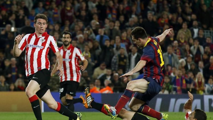Barcelona's Messi is challenged by Athletic Bilbao's De Marcos during their La Liga soccer match at Camp Nou stadium in Barcelona