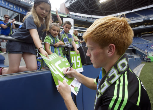 Seattle Sounders' Xander Bailey signs autographs for fans following a friendly soccer match against Tottenham Hotspur in Seattle, Saturday, July 19, 2...