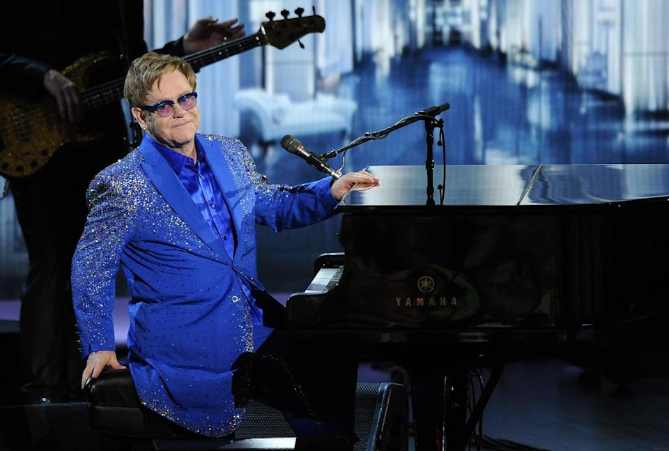 "Elton John performs ""Home Again"" at the 65th Primetime Emmy Awards at Nokia Theatre on Sunday Sept. 22, 2013, in Los Angeles. (Photo by Chris Pizzello/Invision/AP)"