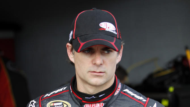 Driver Jeff Gordon walks out of his garage after practice for Sunday's NASCAR Sprint Cup Series auto race at Homestead-Miami Speedway in Homestead, Fla., Friday, Nov. 16, 2012. (AP Photo/Terry Renna)