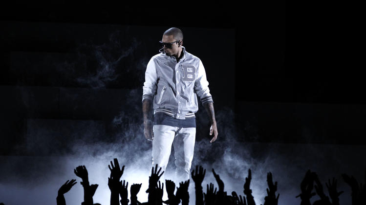 Chris Brown performs during the 54th annual Grammy Awards on Sunday, Feb. 12, 2012 in Los Angeles. (AP Photo/Matt Sayles)