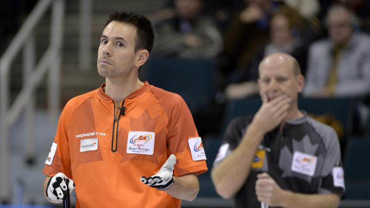 Skip John Epping discusses his next shot with teammates during the game against Team Martin at the Roar of the Rings Canadian Olympic Curling Trials in Winnipeg