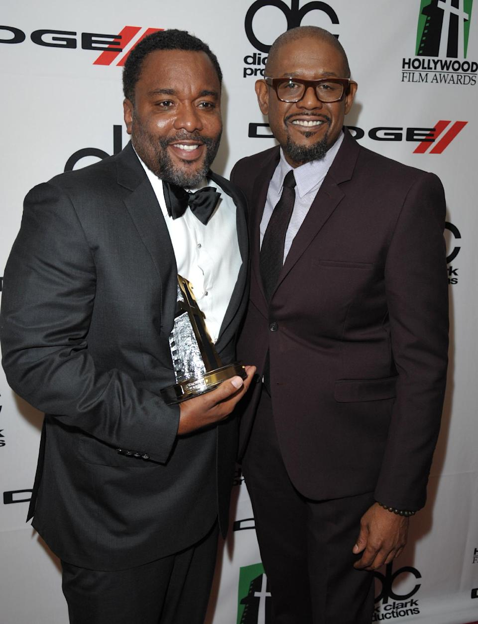 Lee Daniels, winner of the Hollywood director award, left, and Forest Whitaker pose backstage at the 17th Annual Hollywood Film Awards Gala at the Beverly Hilton Hotel on Monday, Oct. 21, 2013, in Beverly Hills, Calif. (Photo by John Shearer/Invision/AP)