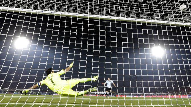 Argentina's Gonzalo Higuain shoots a penalty over the crossbar during penalty shootout at the Copa America final soccer match against Chile at the National Stadium in Santiago, Chile, Saturday, July 4, 2015. Goalkeeper Claudio Bravo made a save and striker Alexis Sanchez converted the winning penalty as host Chile defeated Argentina 4-1 in a shootout after a 0-0 draw in the Copa America final on Saturday, finally winning its first major title.(AP Photo/Natacha Pisarenko)