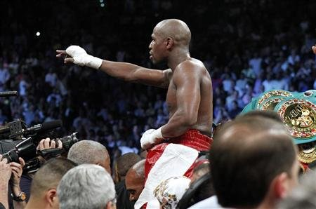 Floyd Mayweather Jr. of the U.S. celebrates his victory over WBA super welterweight champion Miguel Cotto of Puerto Rico following their title fight at the MGM Grand Garden Arena in Las Vegas, Nevada May 5, 2012.