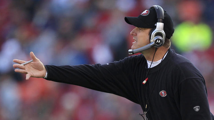San Francisco 49ers head coach Jim Harbaugh gestures from the sideline in the third quarter of an NFL football game against the Arizona Cardinals in San Francisco, Calif., Sunday, Nov. 20, 2011. (AP Photo/Marcio Jose Sanchez)