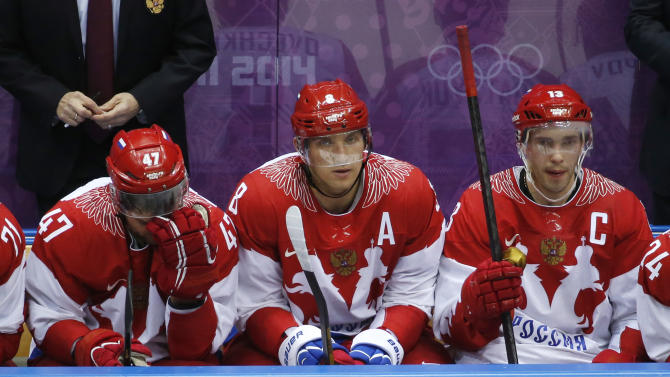 Russia forwards Alexander Radulov, from left, Alexander Ovechkin and Pavel Datsyuk watch play against Finland late in the third period of a men's quarterfinal ice hockey game at the 2014 Winter Olympics, Wednesday, Feb. 19, 2014, in Sochi, Russia. (AP Photo/Mark Humphrey)