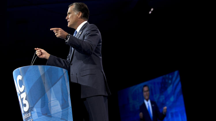Former Massachusetts Gov., and 2012 Republican presidential candidate, Mitt Romney gestures as he speaks at the 40th annual Conservative Political Action Conference in National Harbor, Md., Friday, March 15, 2013. (AP Photo/Jacquelyn Martin)
