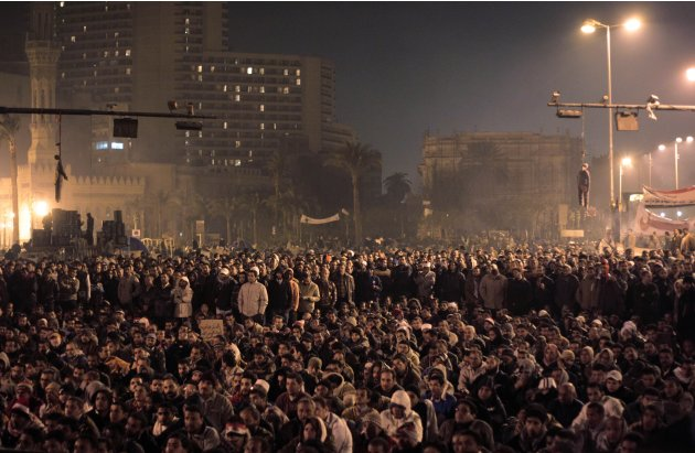 FILE - In this Wednesday, Feb. 2, 2011 file photo, Effigies of Egyptian President Hosni Mubarak can be seen hanging from traffic lights, as Egyptian anti-government protesters gathered in Tahrir (Libe