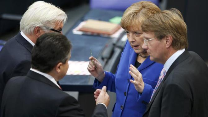 German Chancellor Merkel shakes talks with leader of SPD Gabriel SPD parliamentary floor leader Steinmeier and Federal Chancellery Minister Pofalla prior to constitutional meeting in Berlin