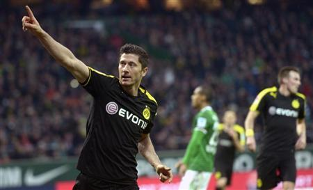 Borussia Dortmund's Lewandowski celebrates after scoring during the German Bundesliga first division soccer match against Werder Bremen in Bremen
