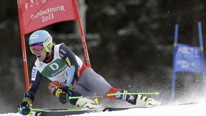 United States's Ted Ligety passes a gate on his way to win the men's giant slalom at the Alpine skiing world championships in Schladming, Austria, Friday, Feb.15, 2013. (AP Photo/Luca Bruno)