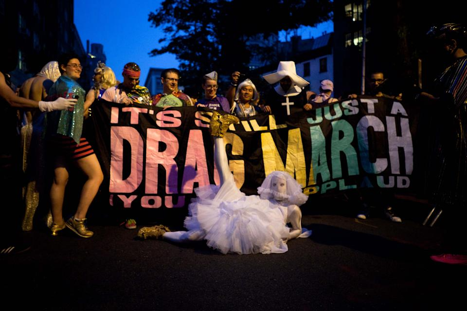 The annual Drag March arrived before the passage of a bill legalizing same-sex marriage in New York State outside the Stonewall Inn on Christopher St, Friday, June 24, 2011, in New York. The measure passed, 33-29, following weeks of tense delays and debate. (AP Photo/John Minchillo)