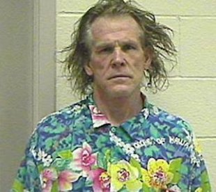 Not so sexy in his 2002 mug shot.