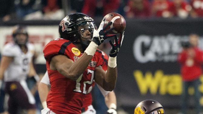 Texas Tech's D.J. Johnson (12) intercepts a pass intended for Minnesota's Derrick Engel (18) during the fourth quarter of the Meineke Car Care Bowl NCAA college football game, Friday, Dec. 28, 2012, in Houston. Texas Tech defeated Minnesota 34-31. (AP Photo/Dave Einsel)