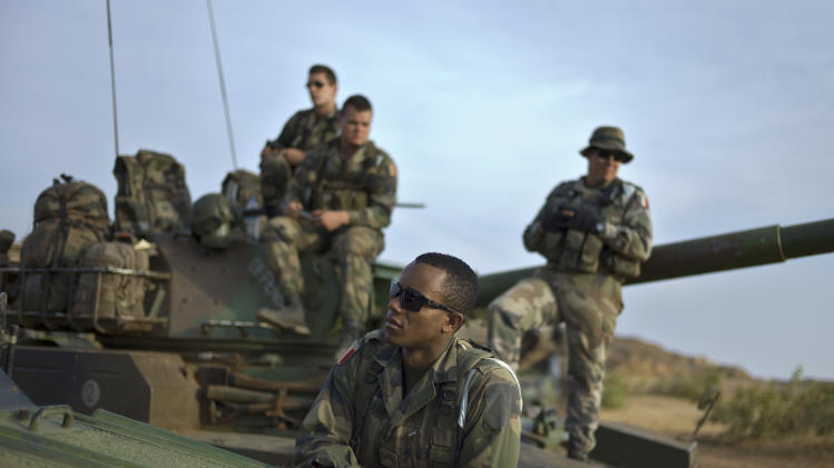 French soldiers are seen during a patrol in the outskirts of Sevare, Mali, some 620 kms (385 miles) north of Bamako, Wednesday, Jan. 23, 2013. The U.S. airlift of French forces to Mali to fight Islamic extremists is expected to go on for another two weeks, Pentagon officials said, as hundreds of African troops from Nigeria, Togo, Burkina Faso and Senegal are now joining the French-led intervention. (AP Photo/Thibault Camus)