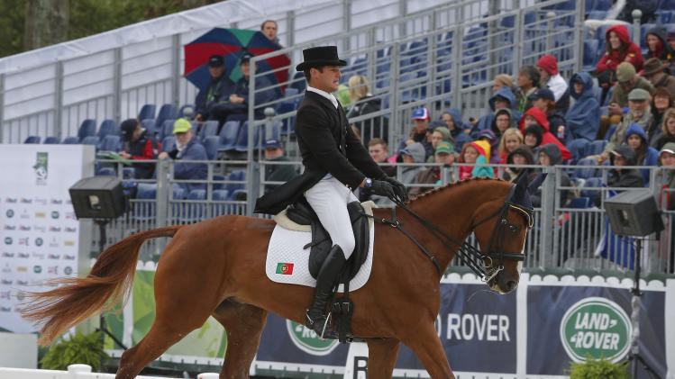 Francisco Seabra of Portugal, riding Zarthago during the first day of the dressage test of the Eventing competition at the FEI World Equestrian Games, at the French National Stud, in Le Pin-au-Haras, western France, Thursday, Aug. 28, 2014. (AP Photo/Michel Euler)