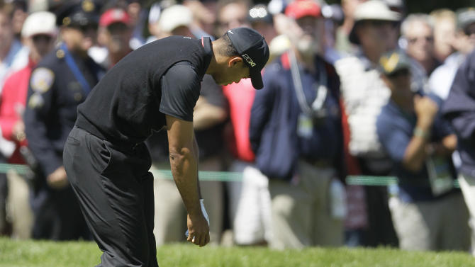 Tiger Woods drops his club after a shot on the sixth hole during the second round of the U.S. Open Championship golf tournament Friday, June 15, 2012, at The Olympic Club in San Francisco. (AP Photo/Eric Risberg)