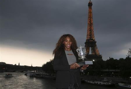 Williams of the U.S. poses with her trophy near the Eiffel Tower in Paris after winning against Sharapova of Russia in the final match at the French Open tennis tournament in Paris