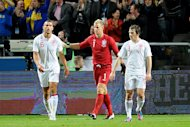 Joe Hart, centre, retains the backing of his England manager despite Wednesday's loss to Sweden