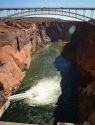 Jet tubes releasing Colorado River water Nov. 19 during a high-flow release at Glen Canyon Dam, the first step in an ongoing experiment to rebuild beaches and fish habitat in the Grand Canyon.