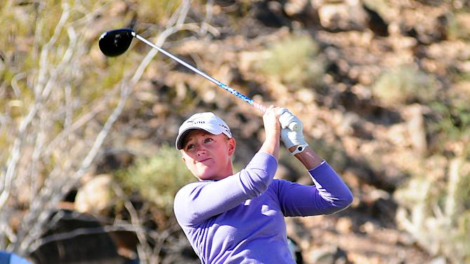 In this photo provided by the Las Vegas News Bureau,  Stacy Lewis competes in the Wendy's 3 Tour Challenge golf tournament at Rio Secco Golf Club in Las Vegas on Tuesday, Nov. 13, 2012. (AP Photo/Las Vegas News Bureau, Steve Spatafore)