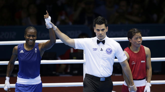 Great  Britain's Nicola Adams, left, and India's Chungneijang Mery Kom Hmangte react following a women's flyweight 51-kg semifinal boxing match at the 2012 Summer Olympics, Wednesday, Aug. 8, 2012, in London. (AP Photo/Patrick Semansky)
